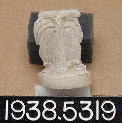 Small statuette of draped female figure