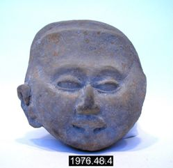 Figurine fragment of smiling head