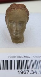 Tanagra Figurine Head- female