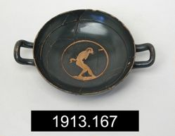 Kylix, showing a silen or satyr peering into a wine spout