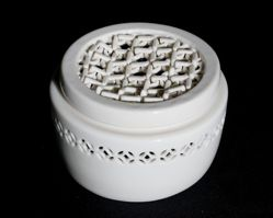 Box with reticulated lid