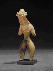 Standing female figurine with hunched posture and long braids