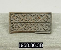 Stamp with Stepped Fret and Shell Design