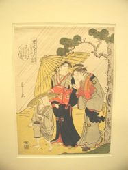 Two ladies and attendant in  rain