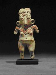 Standing female figurine with diamond shaped eyes, ears spools and short arms
