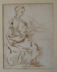 A woman seated at an organ (or writing desk)