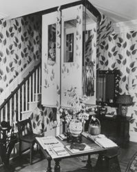 "Interior view of Katherine S. Dreier's Milford home, ""Laurel Manor"" -- KSD in elevator, peering out from L window"