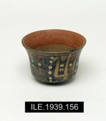 Small cup with bean plant and feline heads