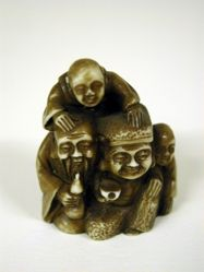 Netsuke : Two men with two boys