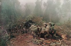 Inspecting 122mm artillery piece near Laotian border, from the series: Larry Burrows: Vietnam, The American Intervention 1962 - 1968