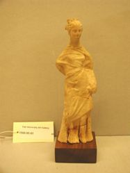 Standing female figurine.