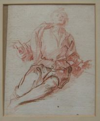 A seated man with arms open
