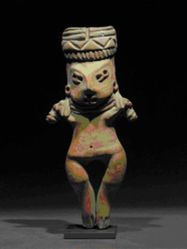 Standing figure with zigzag design in headdress