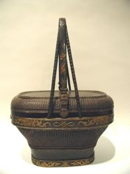 Lacquered basket with upright handles and lid