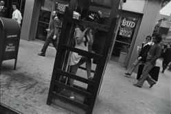 New York City 1972 (Girl in Telephone Booth), from the Garry Winogrand portfolio, 1978