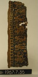 Strip of textile in blue/purple and white with Dionysian figures
