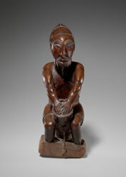 Figure of a Drum Player