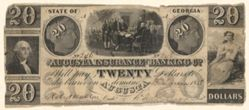 20 Dollar bill issued by the Augusta Insurance & Banking Co., Augusta, Georgia in 1858 with engravings of Declaration of Independence after Trumbull, Washington after Stuart (?)