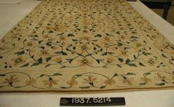 Embroidered bath mat of plain cloth
