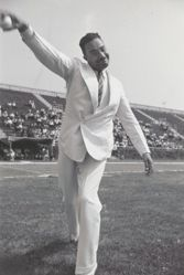 Judge Page, the first black appointed to the  City Bench, throws out the first pitch at Randall's Island, New York