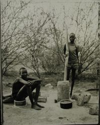 William Biar Gai and Bol Aguot, preparing millet, Sudanese refugee camp, Kakuma, Kenya