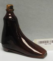 Bottle In Form Of Shoe With Cork