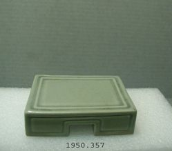 Heavily potted rectangular celadon stand