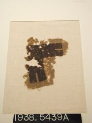 Textile fragment with brown pattern