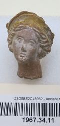Head of female figurine