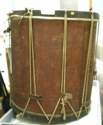 Drum with two attached sticks
