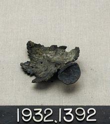 Bronze heat shield in shape of leaf