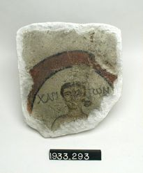 Painted Tile with Man's Head Inside Circle