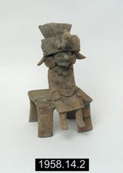 Seated Female Figurine Wearing Buccal Mask