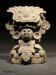 Urn of a Seated Figure Wearing a Buccal Mask