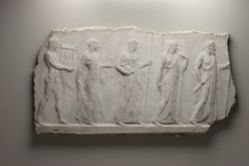 Archaistic relief showing five divinities: Zeus, Hera, Athena, Aphrodite, and Apollo.