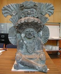 Urn Representing a Seated Man with a Tall Headdress
