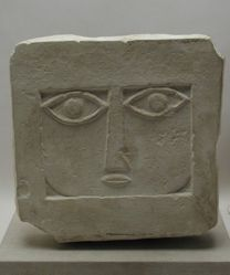 Stele with abstract female face
