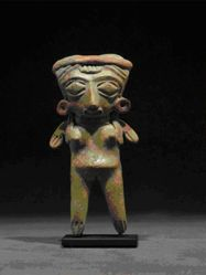 Standing female figurine with headband, ear spools and long hair with braids