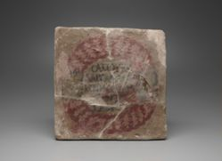Tile with Greek Inscription in Wreath