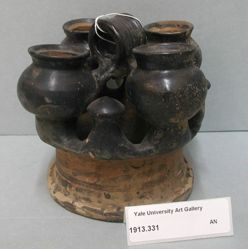 Small cups attached to ring-shaped base