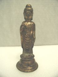Standing Buddha on pedestal
