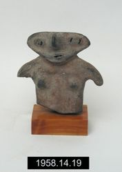 Slab figurine of woman