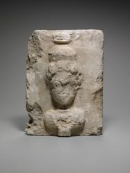 Plaster block with relief bust