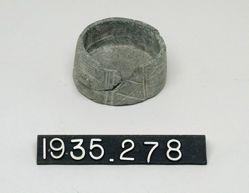 Flat stone vessel