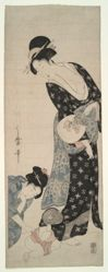 Baby peering through its mother's kimono