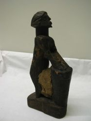 Human Figure with Drum
