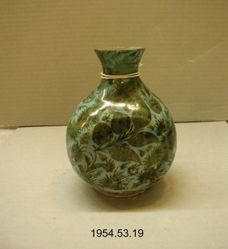 Flask with Leaves and Flowers