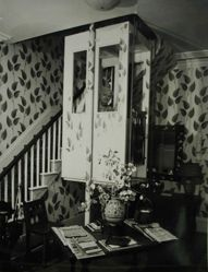 "Interior view of Katherine S. Dreier's Milford home, ""Laurel Manor"" -- KSD in elevator, peering out from R window"