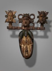 Mask Surmounted by Three Human Heads