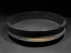 Large low bowl with flanges around rim and base